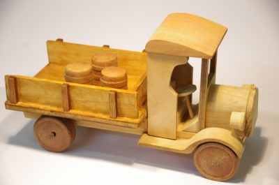 Wooden vintage toy truck with natural finish